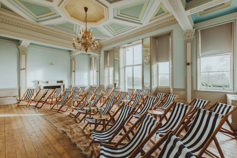Rows of deck chairs in the screening room at Birch, Hertfordshire