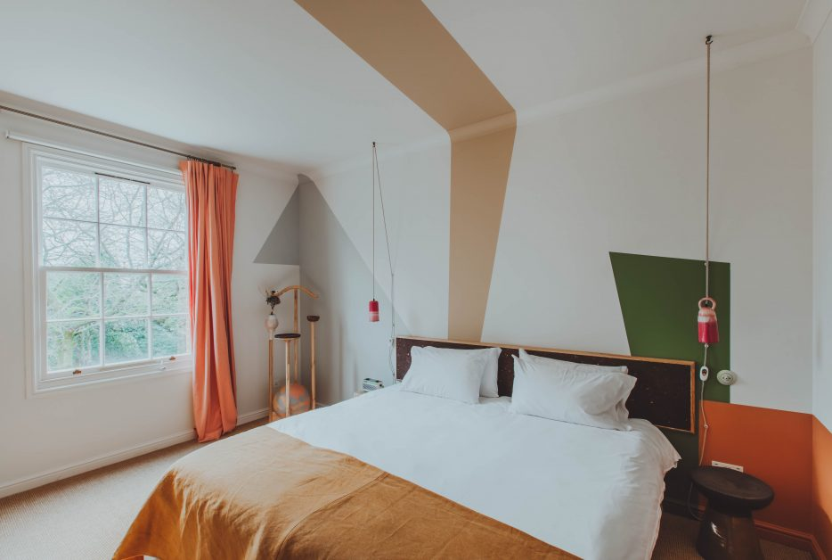 A stylish bedroom with double bed at Birch, Hertfordshire