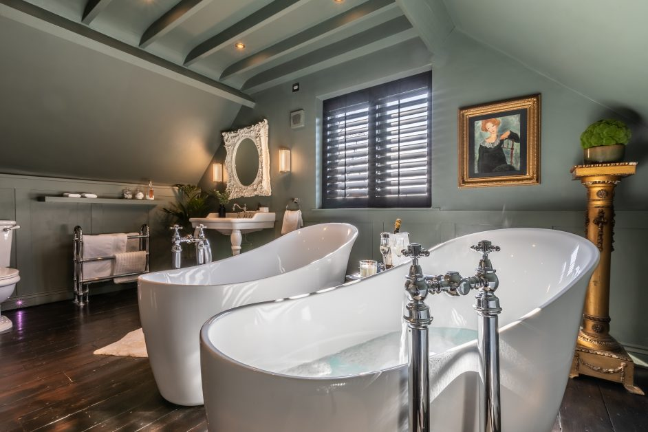 Two luxury bath tubs side by side at Peony Cottage in the Cotswolds