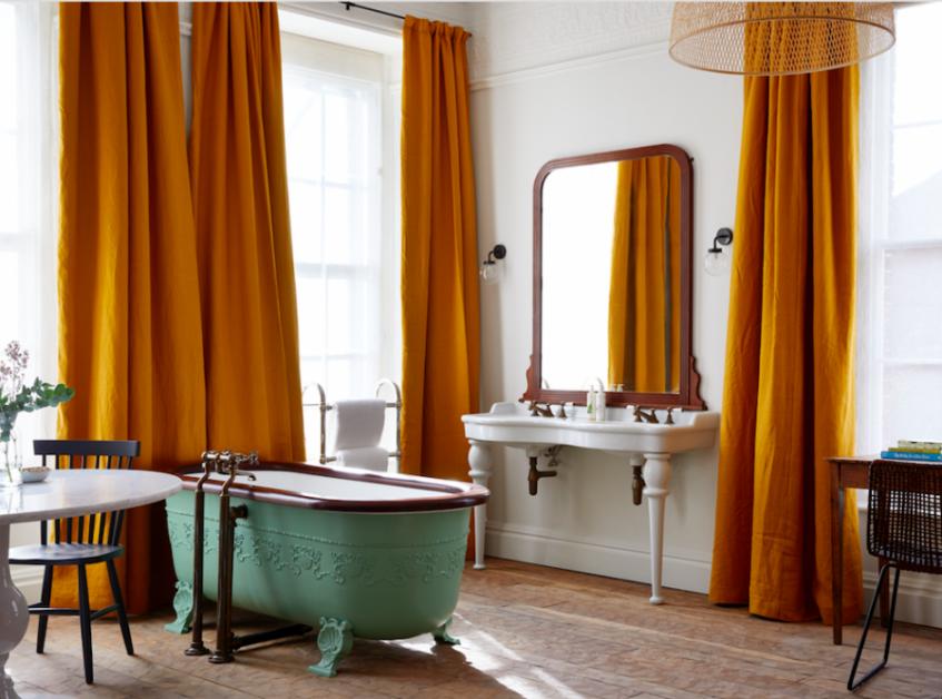 Freestanding bath tub in room at Artist Residence Bristol