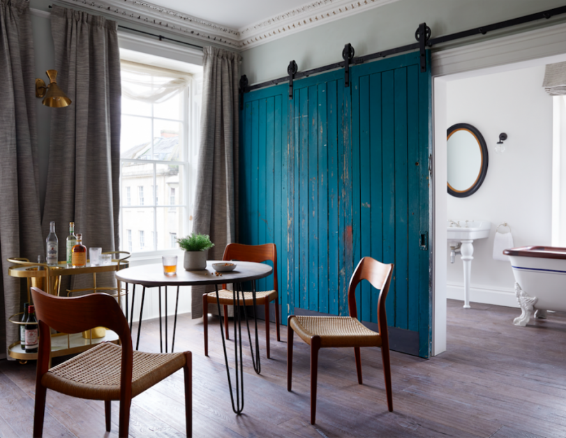 A drinks trolley and seating area in one of the rooms at the new Artist residence boutique hotel in Bristol.