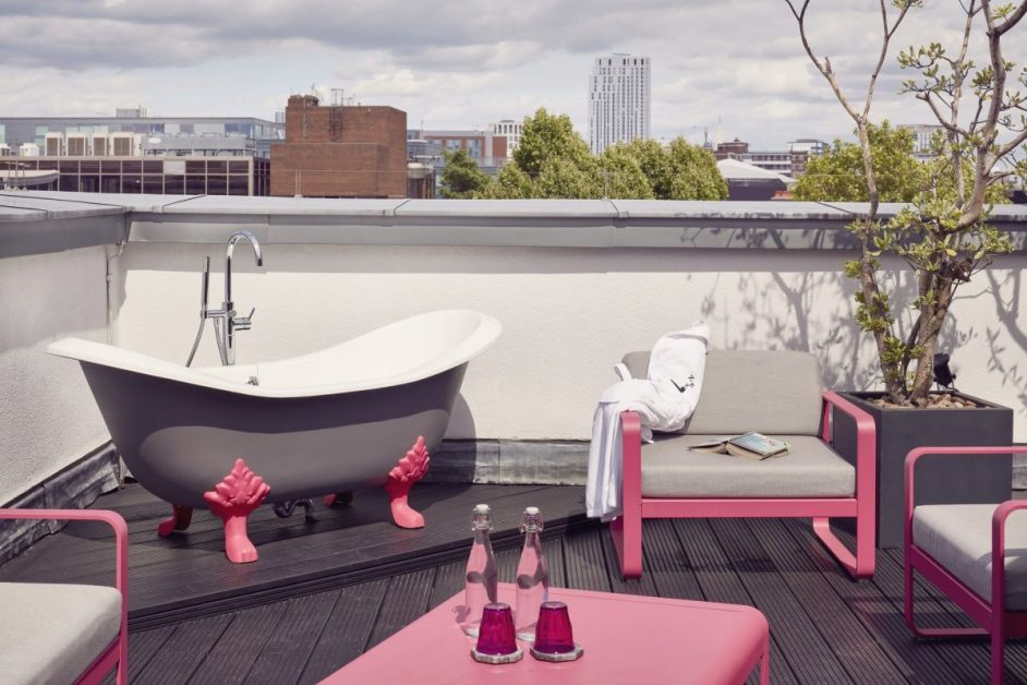 Grey freestanding bath with pink legs on the roof terrace of the Zetter Townhouse hotel