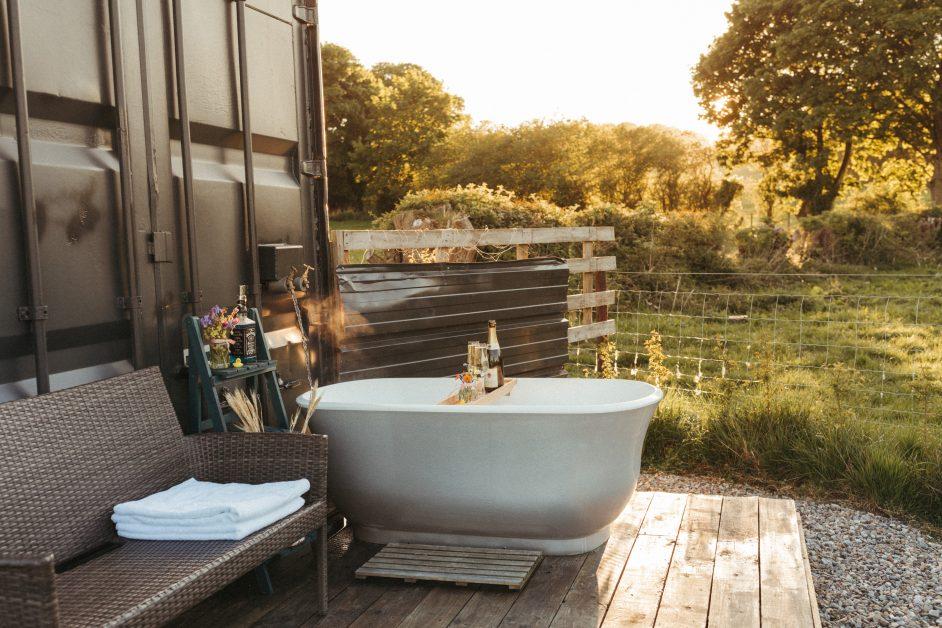 White outdoor freestanding bath tub with champagne at Trelan Farm