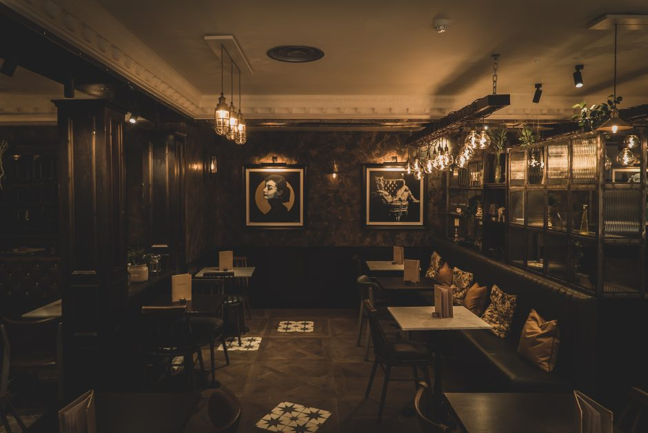 The dark interior with pictures on the wall at Six by Nico London