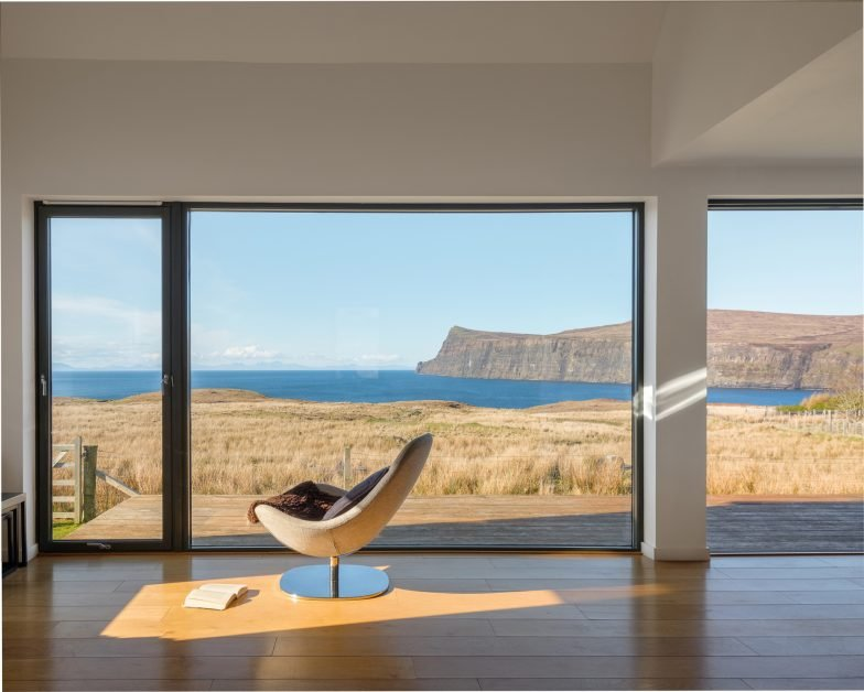 Egg chair in a stylish apartment looking out across the sea on the west coast of Skye Scotland
