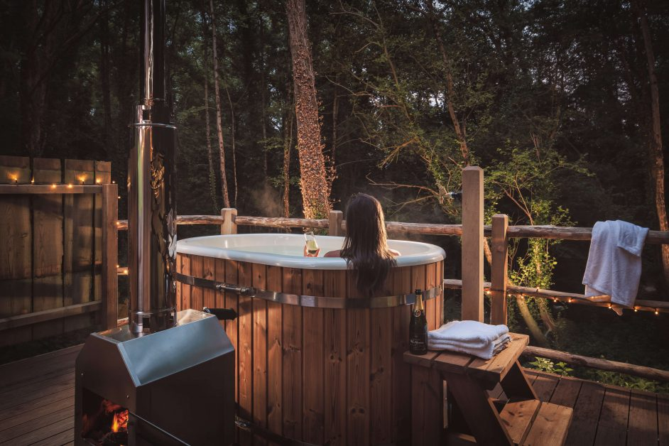 The outdoor wood fired hot tub at The Birdhouse Treehouse