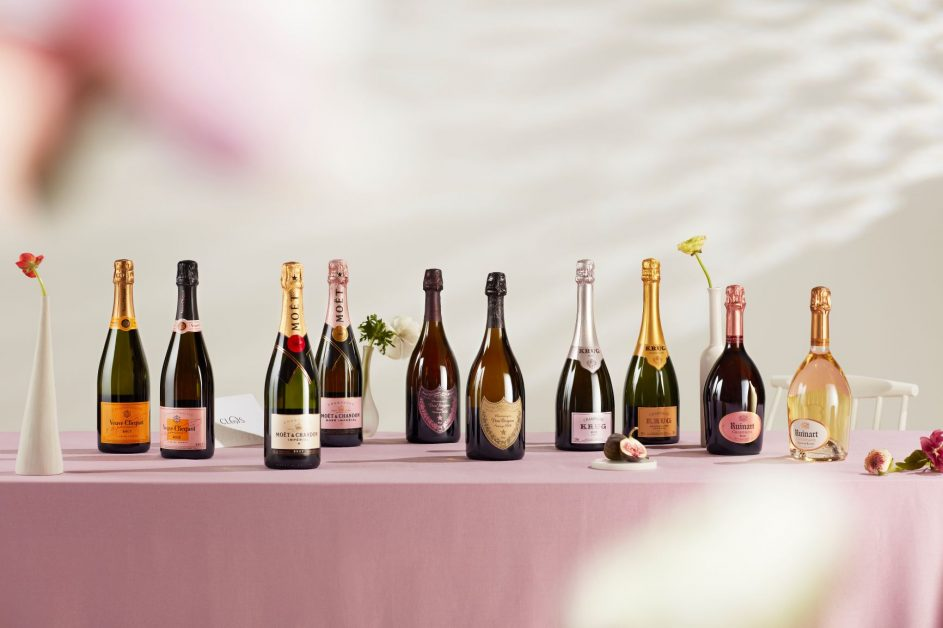 Beautiful champagne bottles lined up on a table