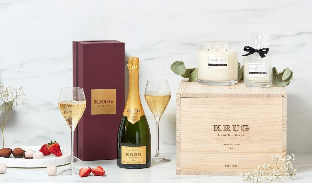 champagne bottle with two poured glasses pretty lifestyle shot