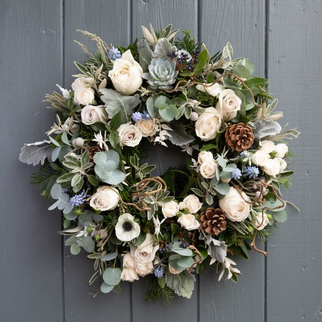 Nordic Christmas Rose Door Wreath by The Real Flower Company