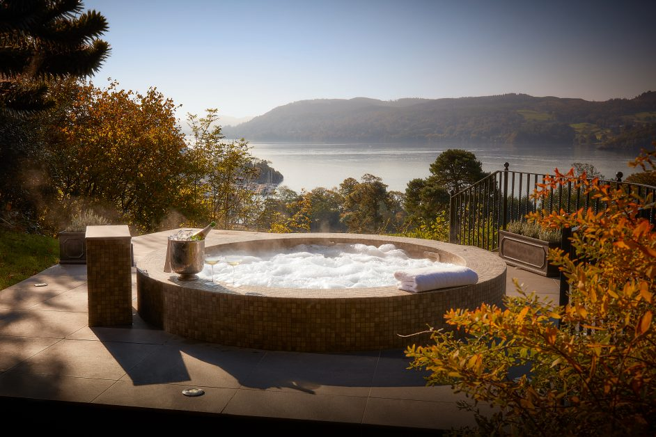 A bubbling mosaic hot tub with champagne overlooking Lake Windemere