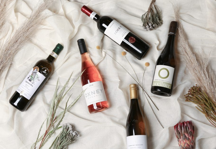 wine bottles lay down with flowers