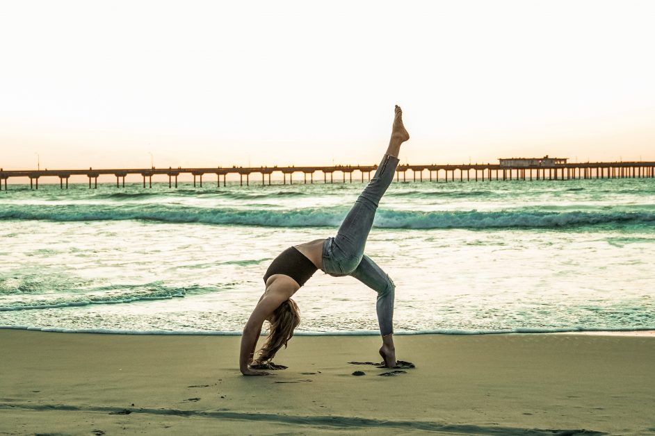 Outdoor exercise yoga on beach fitness trends 2021