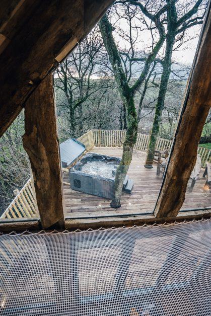 Hot tub view from hammock Prince Llywelyn luxury treehouse