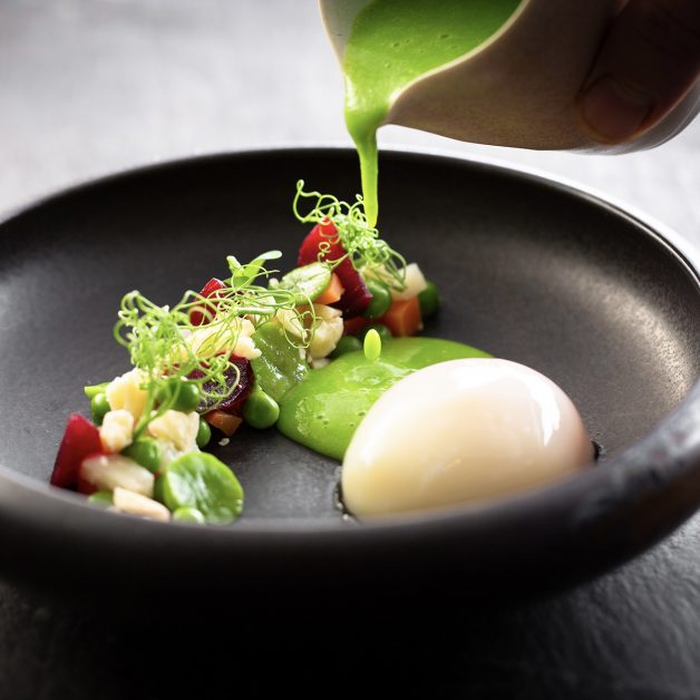The 63-degree egg with spring vegetables and pea velouté.