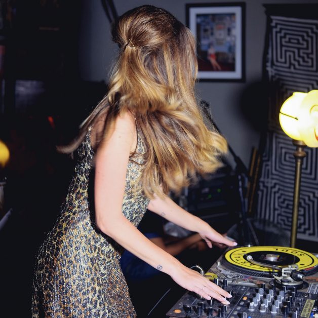 DJ in leopard print dress - how to throw a post-lockdown party
